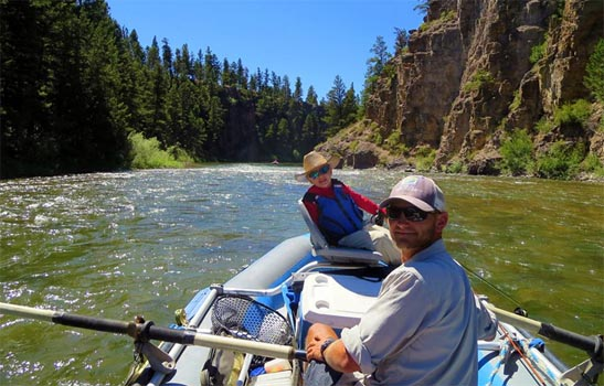 Blackfoot River Fly Fishing Guide and Young Fisherman in Raft on the Blackfoot River