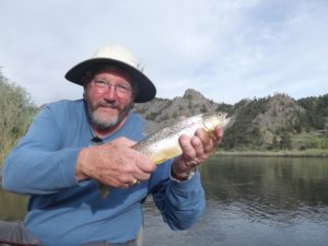 Fly Fisherman Holding A Brown Trout added to testimonials page