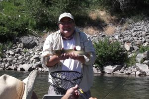 Fisherman with Blackfoot River Cutthroat on testimonials page