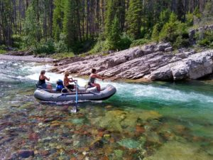 Man and 2 women in raft fishing on the South Fork Flathead River added to Contract and Agreement Forms page